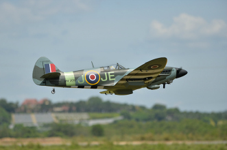 Phoenix Models Spitfire 50-61cc:Flying by with landing gear retracted.