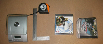 Digital scale,tape measure,square and CD cases. All needed for RC plane CG balancer.