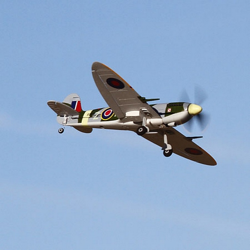 Nice flying shot of the Spitfire.