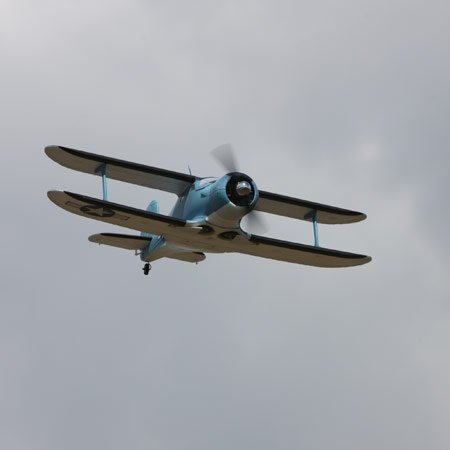 The E-flite Beechcraft Staggerwing RC scale model,flying towards camera.