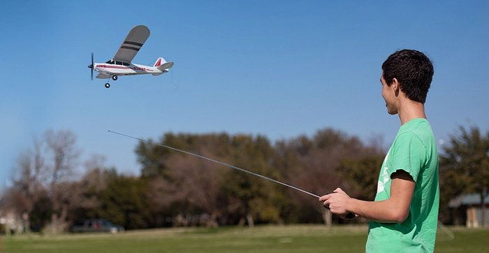 Young boy fling electric RC airplane