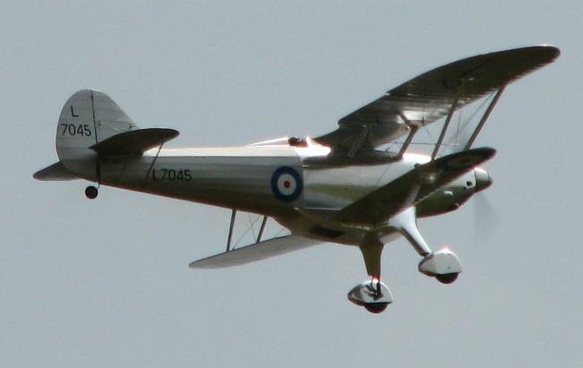 The Fairey Fantome 1/5 scale RC model flying by.